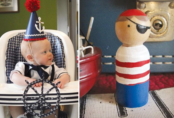 nautical first birthday high chair with the birthday boy in his party hat