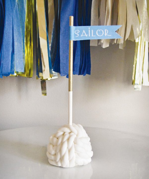 "nautical first birthday party rope cake pop with ""ahoy"" flag"