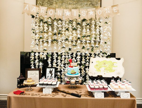 neverland inspired first birthday party dessert table