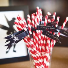 neverland inspired first birthday party striped red pirate straws with hoho flags and tinkerbell