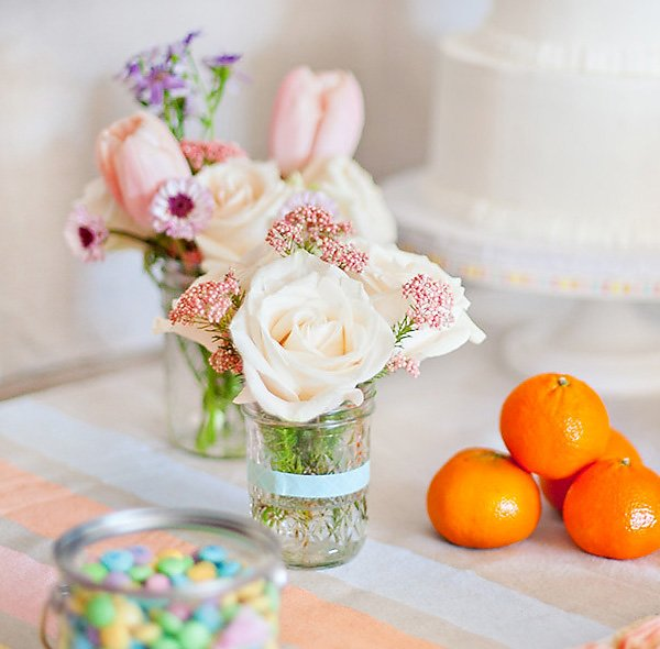 pink roses in vintage mason jars centerpiece