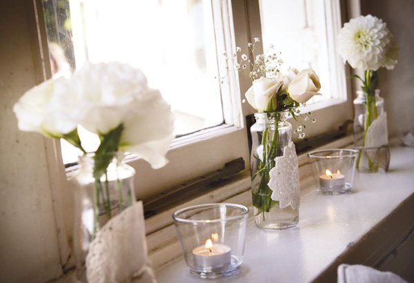 simple white wedding flowers in vases