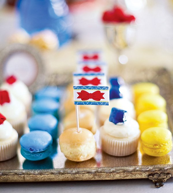 snow white party cupcakes with edible gems and blue macarons