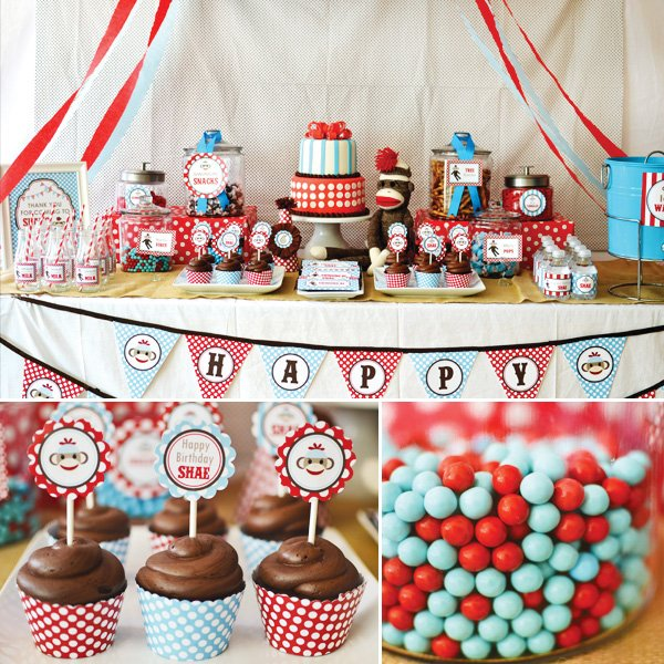 sock monkey birthday party dessert table with cupcakes and sixlets