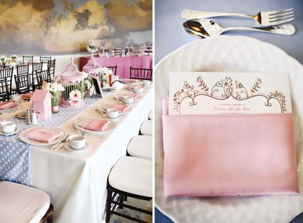 table setting with designed menus and pink napkins