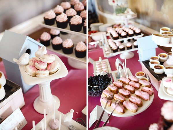 bird bath with macaroons and other pink frosted desserts