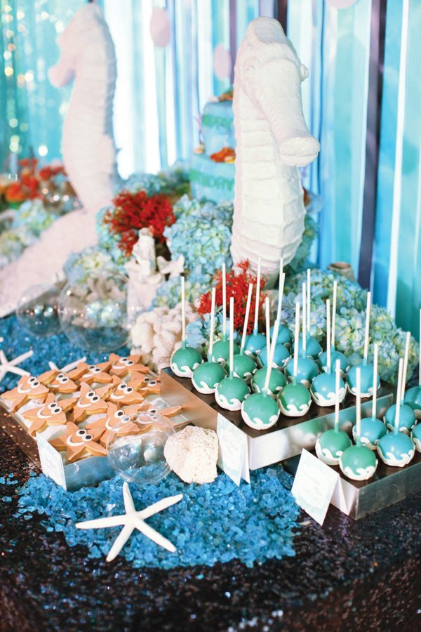 under the sea themed desserts with seahorse centerpiece