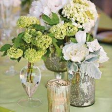 vintage green party floral arrangement in mercury glass vases