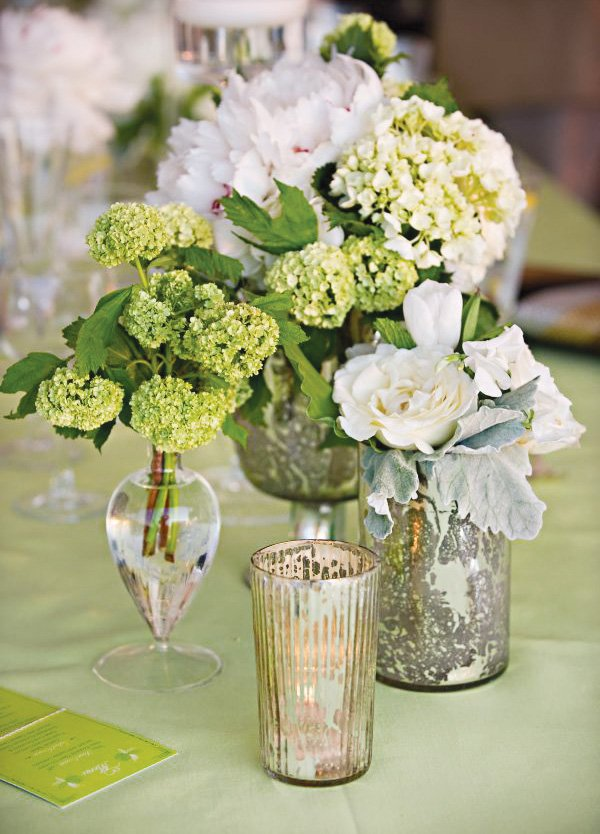 vintage green party floral arrangement in mercury glass vases