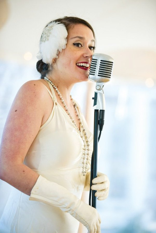 vintage party singer at a microphone