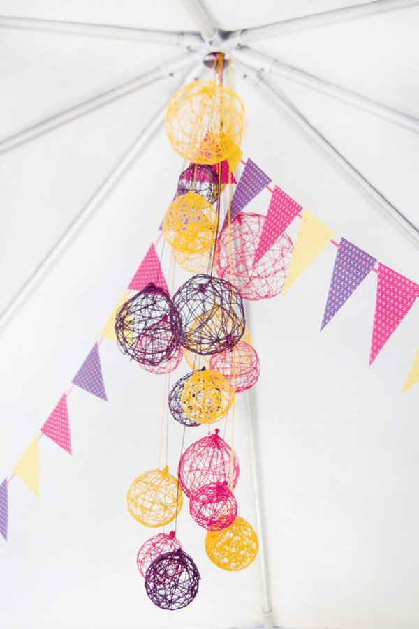 pink purple and yellow yarn ball chandelier