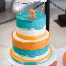 airplane party orange and teal cake