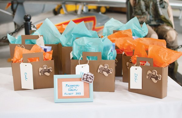 airplane party with suitcase favors