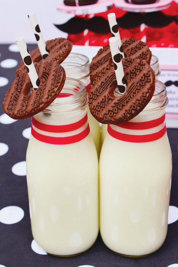 bowling party drinks - bowling pin milk bottles with bowling ball cookies