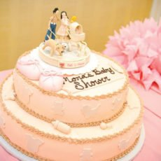 burberry baby shower with a pink cake and portrait fondant topper