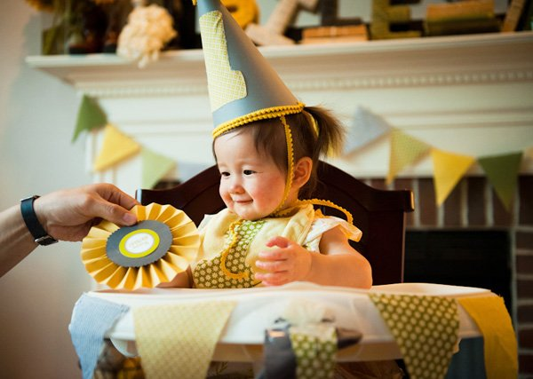 county fair first birthday party - birthday hat and high chair