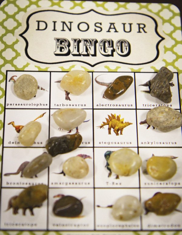 dinosaur boy birthday party bingo with rocks game