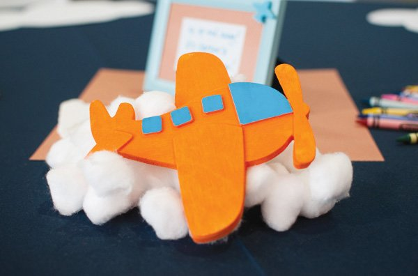 airplane party centerpieces - diy wooden planes on cotton ball clouds