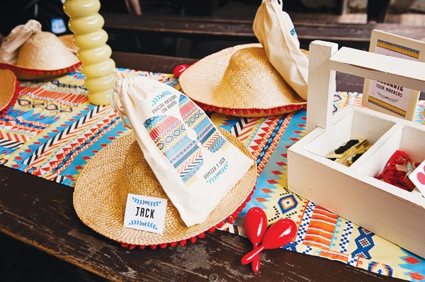 fiesta mexicana twins birthday party table setting with sombreros