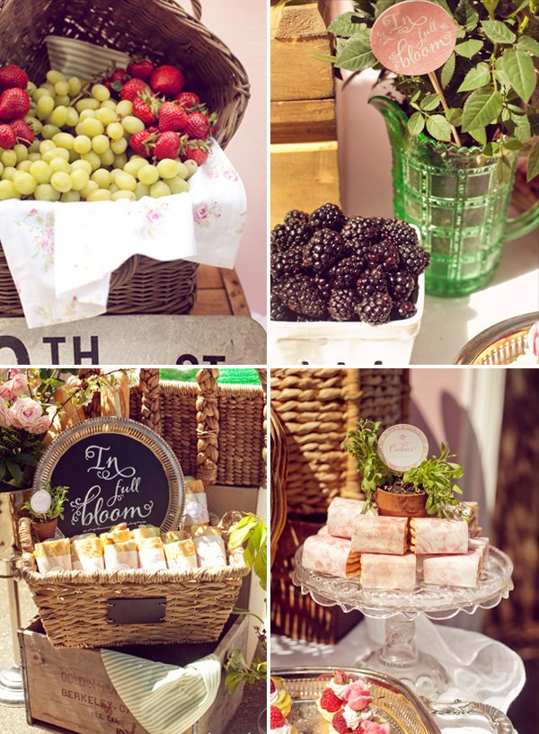 French baby shower food - trays and baskets of fruit and sandwiches