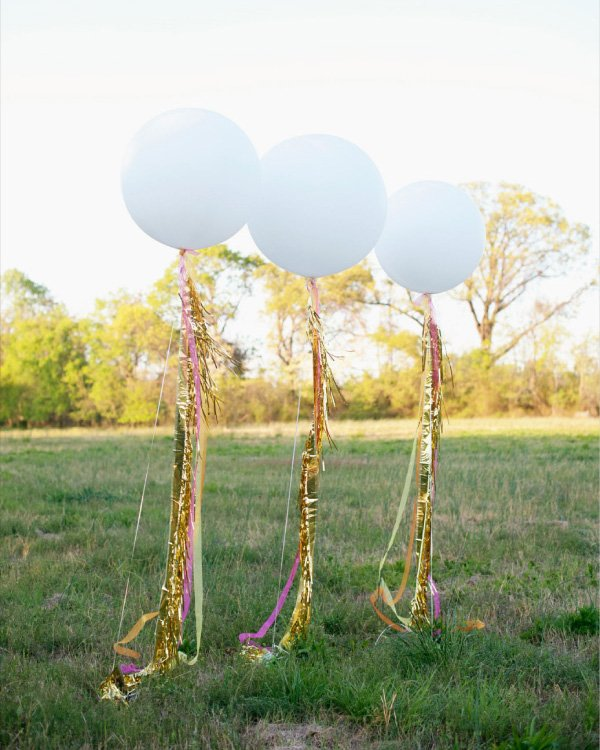 giant balloons with neon tinsel ribbons