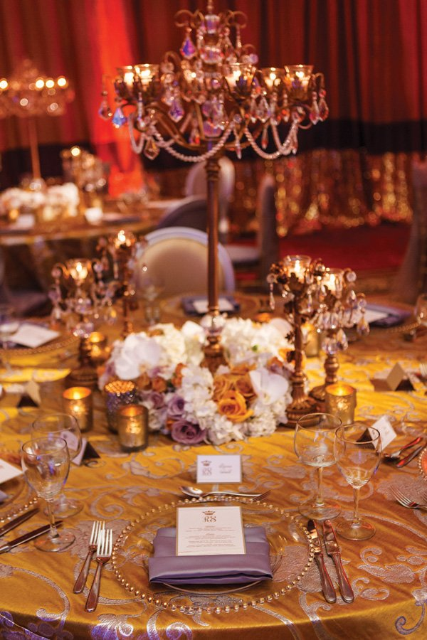 gold and ivory regal wedding place setting and centerpiece