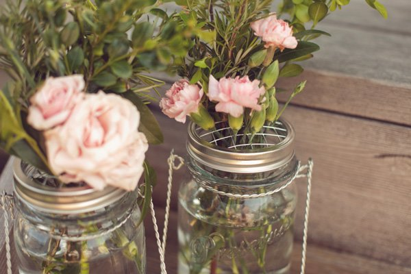 french baby shower with flowers in mason jars