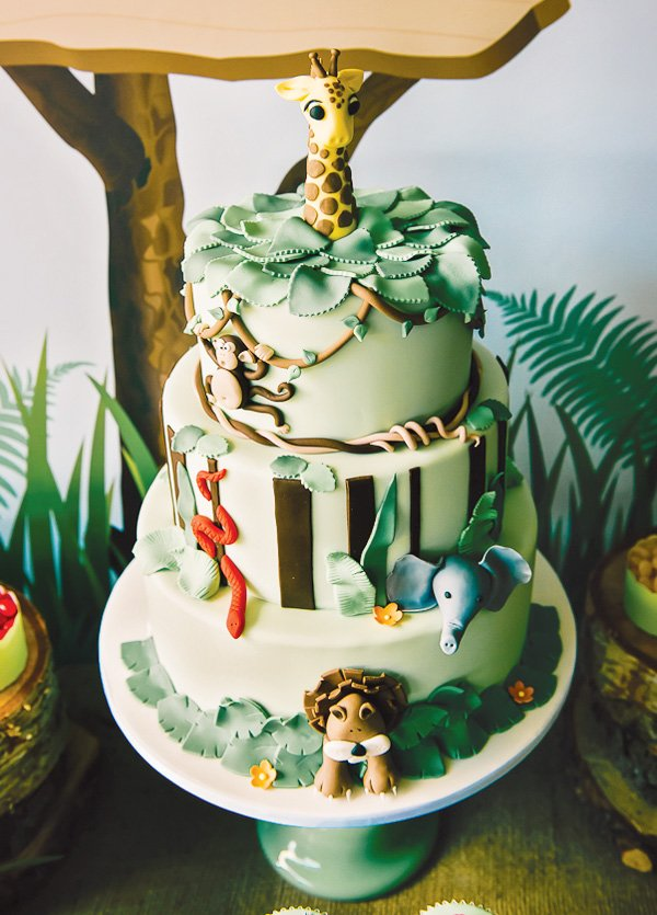 jungle cake with a fondant giraffe topper