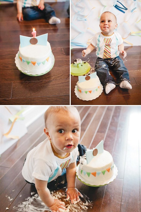 little man first birthday with a smash cake