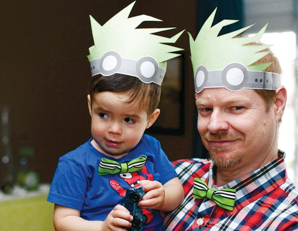 adult mad scientist dinner party with hats and bow ties