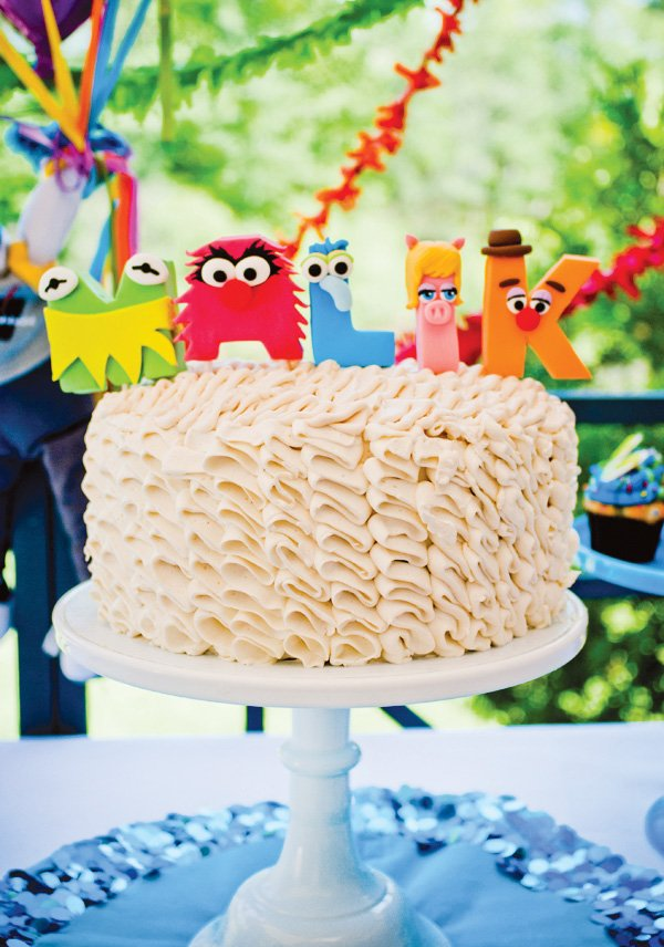 muppet themed birthday cake with white ruffles