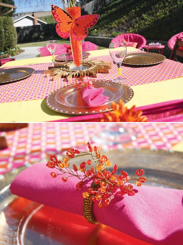 pink table setting and butterfly centerpiece