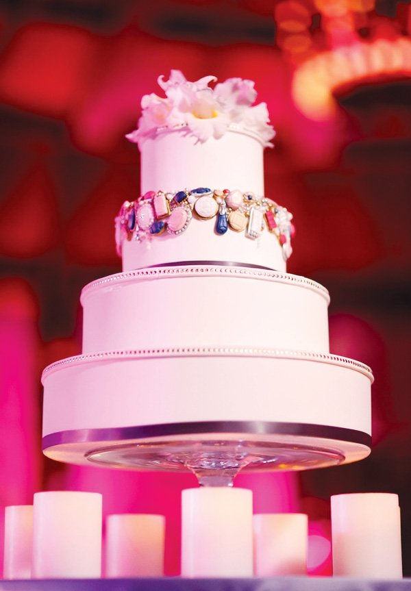 pink wedding with a jeweled 3 tier cake