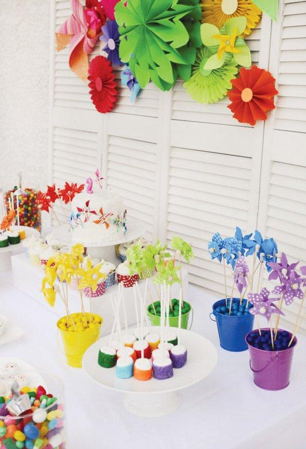 rainbow pinwheel party theme dessert table