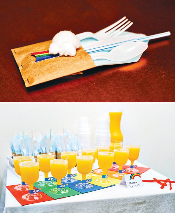 rainbow birthday brunch with special utensil packets and mimosas