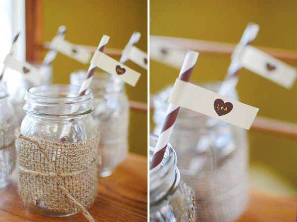 burlap wrapped mason jars with striped straws and flags