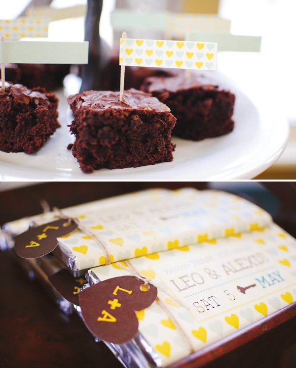 a rustic couples shower with chocolate bar wrappers and food flags