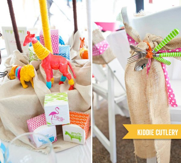 sunshine safari baby shower centerpiece and decorated chairs