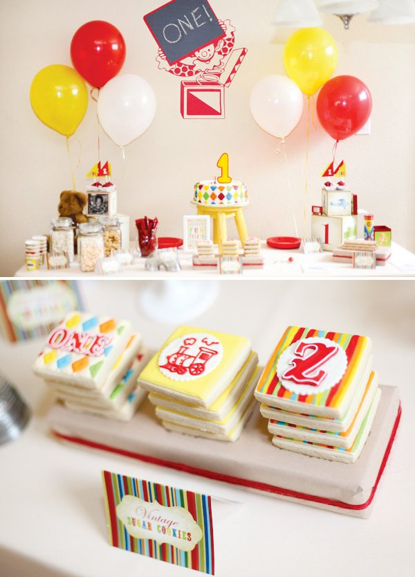 vintage toy first birthday dessert table
