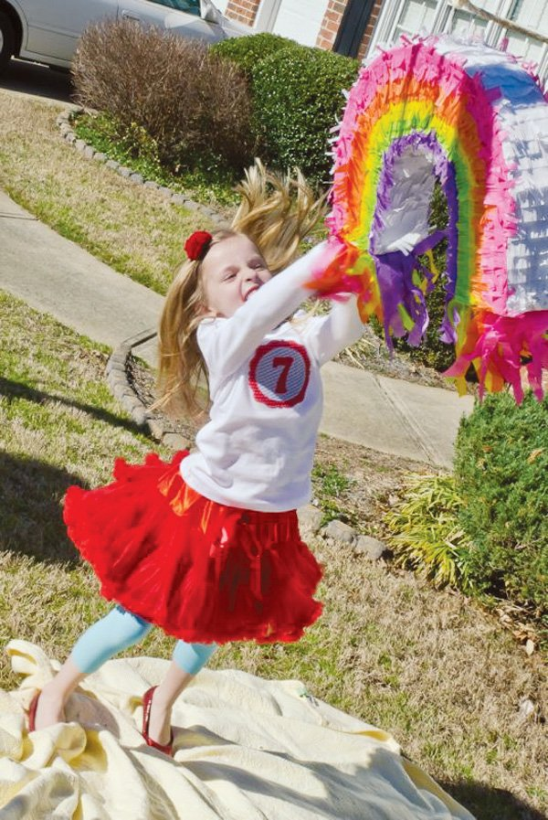 wizard of oz birthday party with a rainbow pinata