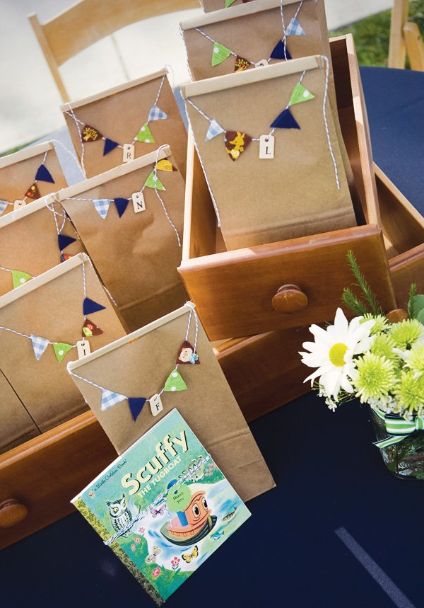 Paper bag party favors with mini bunting