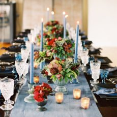 tablescape with blue candlesticks and asymmetrical styling