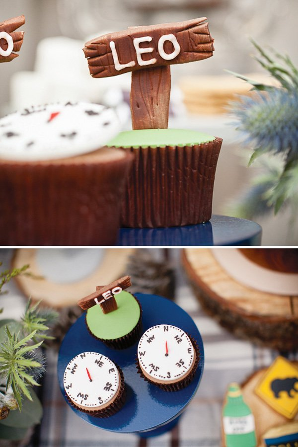 Camping cupcakes with fondant compass toppers