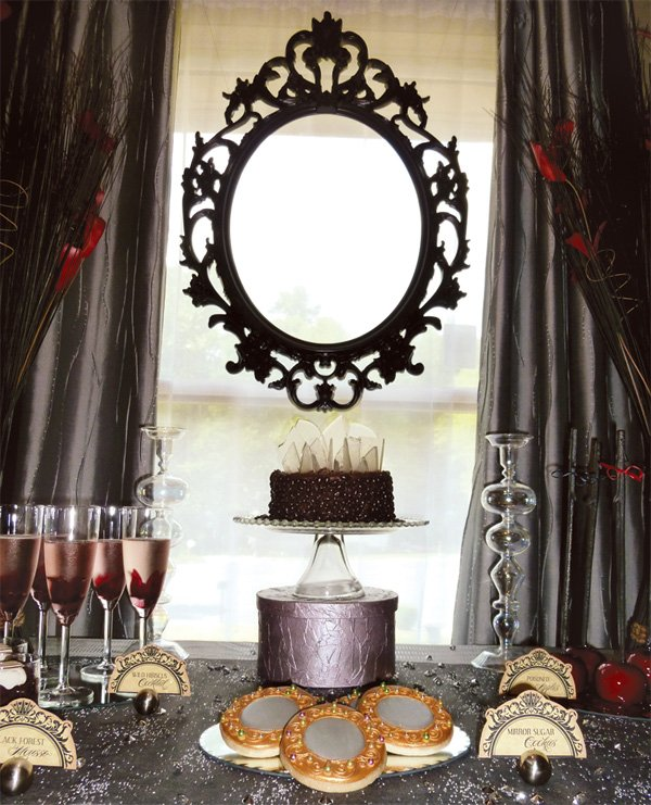 evil queen from snow white party dessert table