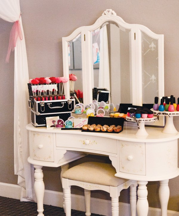 project runway birthday party with a makeup dessert table