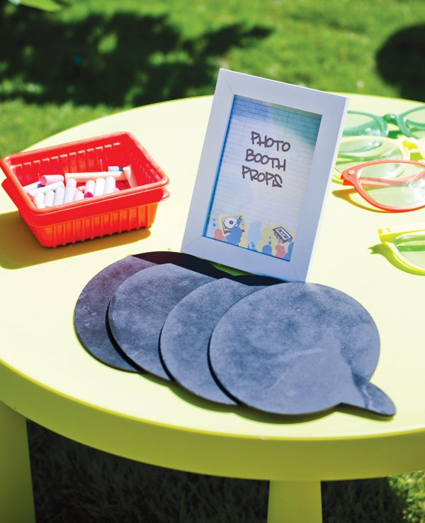 Graffiti photo booth with chalkboard word bubble props