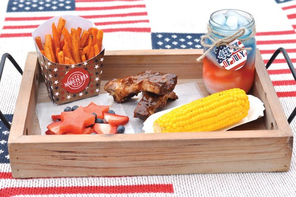 july 4th bbq with corn, sweet potato fries, star shaped watermelon & patriotic juice