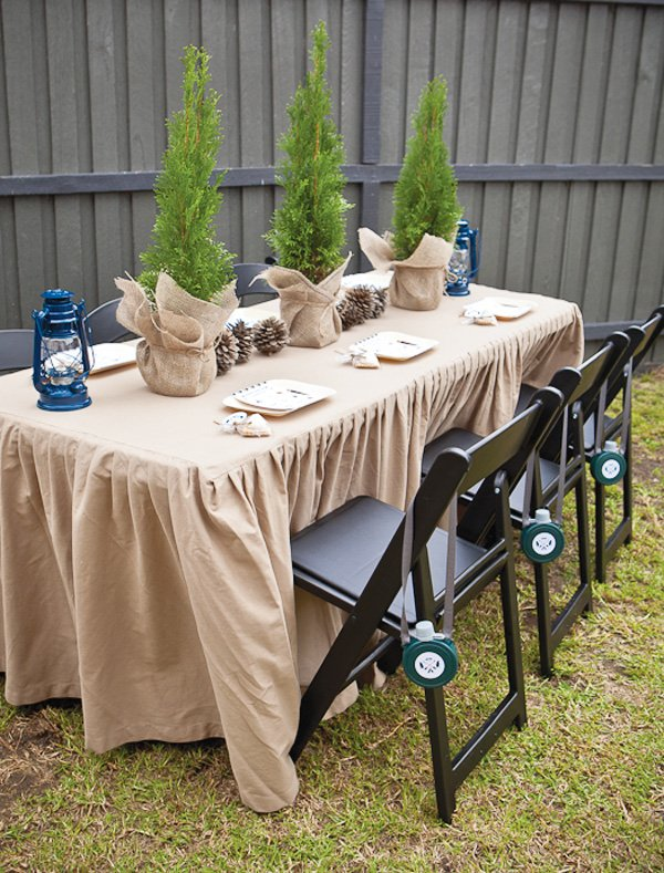 winter camp party tablescape with pinecone centerpieces