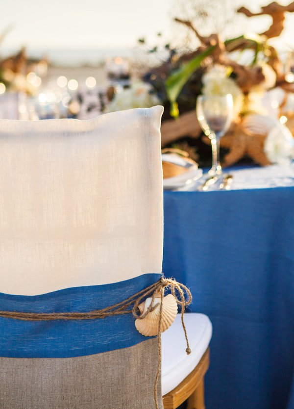 beach wedding chairs with sea shell accents