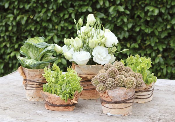 rustic wedding centerpiece using recycled containers and bark